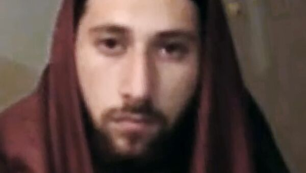 An image grab taken from a video released on July 27, 2016 by Amaq News Agency, an online service affiliated with the Islamic State (IS) group, purportedly shows French jihadist Abdel Malik Petitjean, 19, identifying himself as Ibn Omar, one of the two men who stormed into a church in the northern French town of Saint-Etienne-du-Rouvray during morning mass and cut the throat of a 86-year-old priest at the altar. - Sputnik France
