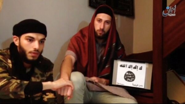 This still image taken from video shows the two men, Abdel-Malik Nabil Petitjean and Adel Kermiche, behind the church attack in Normandy in this video released July 28, 2016. Handout via Reuters - Sputnik France