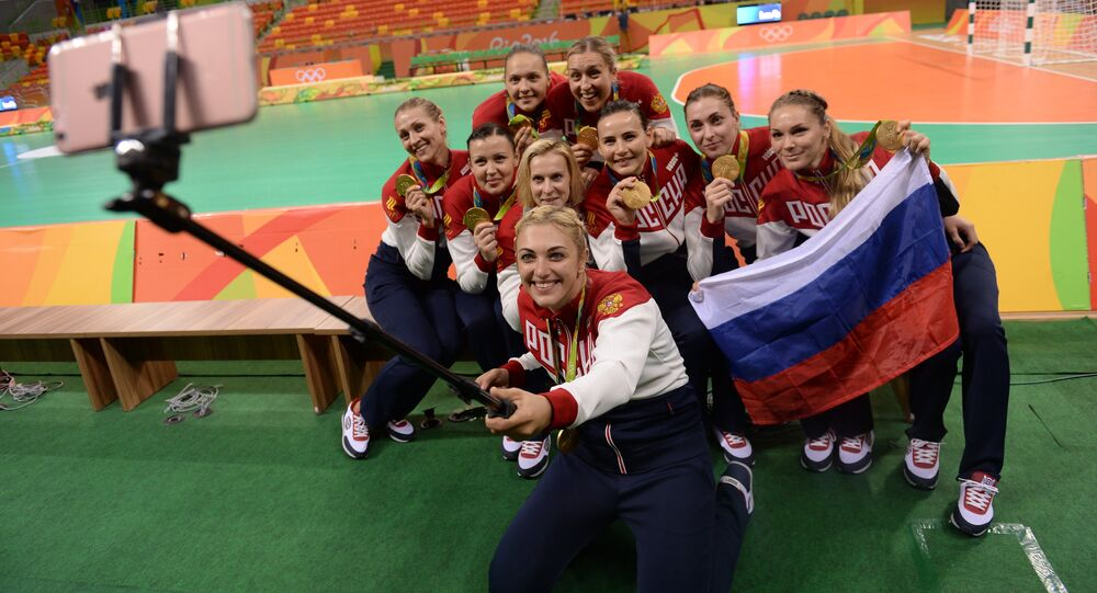 The Russian national team, winners of the gold medal in women's handball at the XXXI Summer Olympics, during the medal ceremony