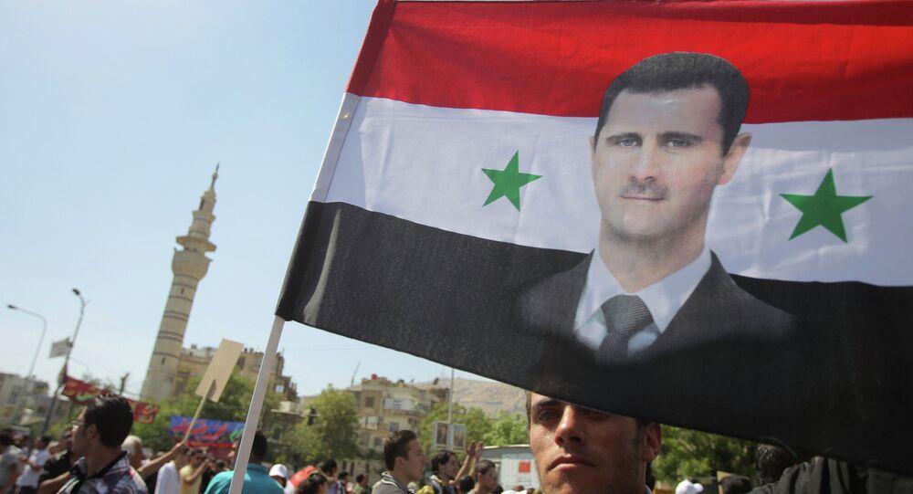 Drapeau à l'effigie de Bachar el-Assad à Damas