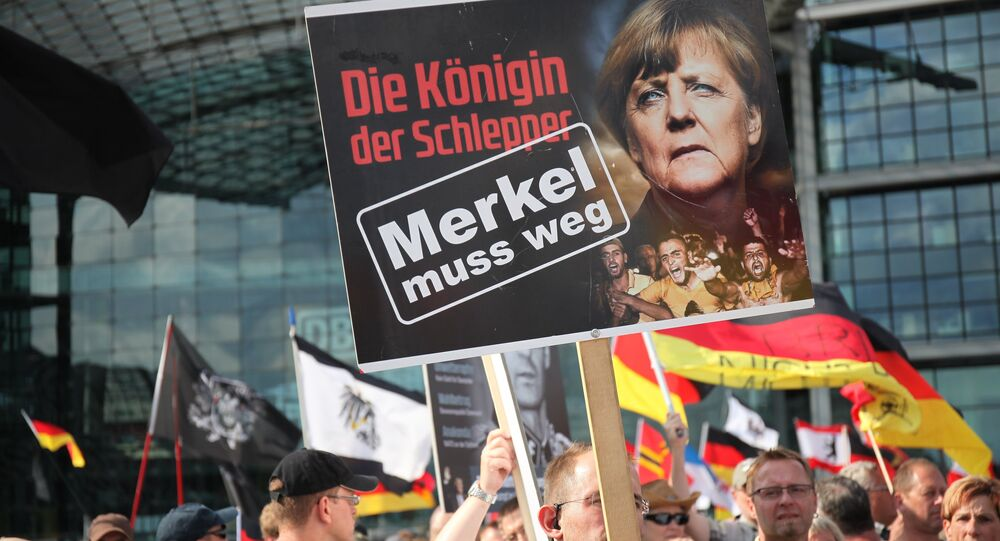 Une action de protestation contre la politique d'Angela Merkel à Berlin