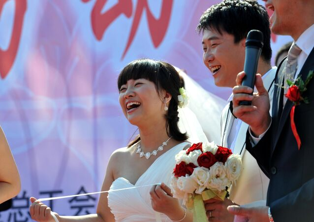 In this picture taken on October 6, 2011 twenty one Chinese couples take part in a group wedding ceremony held at Haidian Park Center in Beijing.