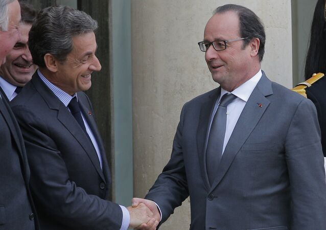 French President Francois Hollande, right, shakes hands with Nicolas Sarkozy, former French President and head of the conservative Les Republicains party, after a meeting at the Elysee Palace, in Paris, Friday, Jan. 22, 2016.