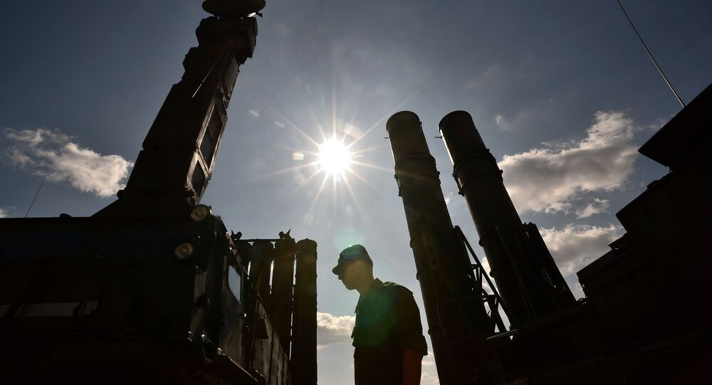 A serviceman stands near an S-300 surface-to-air missile system. (File)