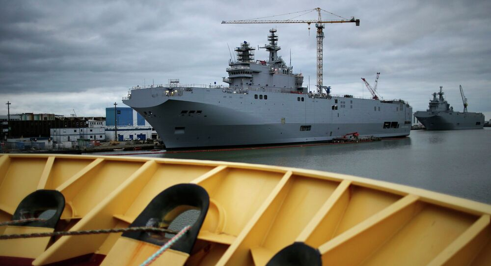 The two Mistral-class helicopter carriers Sevastopol (L) and Vladivostok are seen at the STX Les Chantiers de l'Atlantique shipyard site in Saint-Nazaire, western France, December 23, 2014.