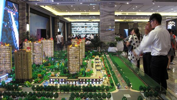 Models of residential buildings are seen at a sales center in Zhengzhou, Henan province, China, September 23, 2016. - Sputnik France