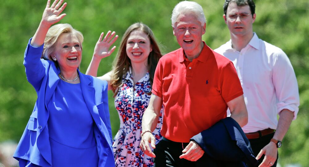 Democratic presidential candidate former Secretary of State Hillary Rodham Clinton waves to supporters as her husband former President Bill Clinton, second from right, Chelsea Clinton, second from left, and her husband Marc Mezvinsky, join on stage Saturday, June 13, 2015, on Roosevelt Island in New York