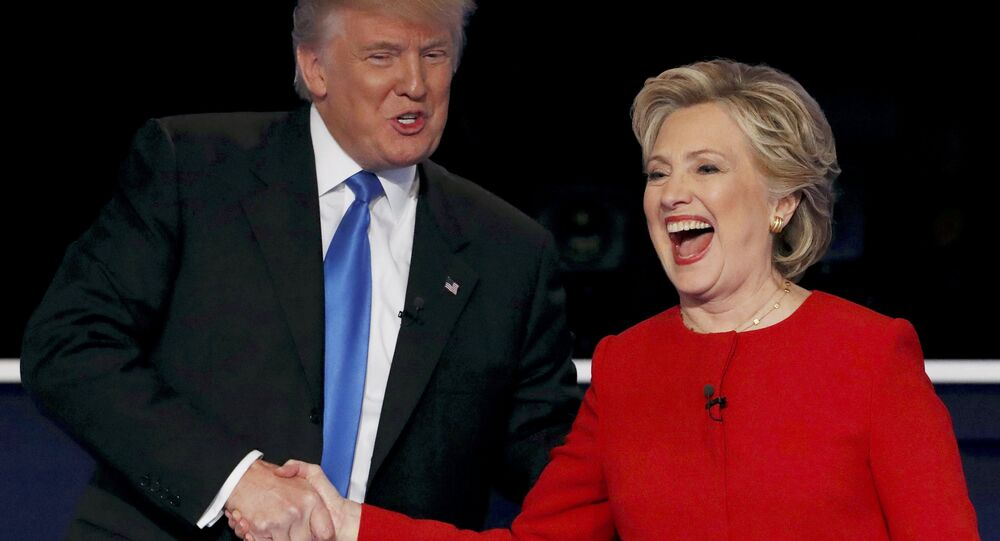 Republican U.S. presidential nominee Donald Trump shakes hands with Democratic U.S. presidential nominee Hillary Clinton