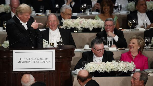 Democratic presidential candidate Hillary Clinton, right, reacts as Republican presidential candidate Donald Trump speaks during the Alfred E. Smith Memorial Foundation dinner, Thursday, Oct. 20, 2016, in New York. - Sputnik France