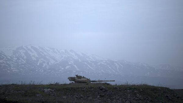 An old Israeli tank sits in a position in the Israeli-controlled Golan Heights near the border with Syria, Tuesday, Jan. 27, 2015. - Sputnik France