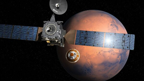 Artist's impression provided by the European Space Agency, ESA, depicting the separation of the ExoMars 2016 entry, descent and landing demonstrator module, named Schiaparelli, center, from the Trace Gas Orbiter, TGO,lrft, and heading for Mars - Sputnik France