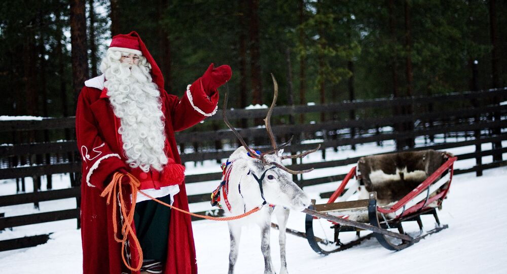 Le père Noël avec ses rennes