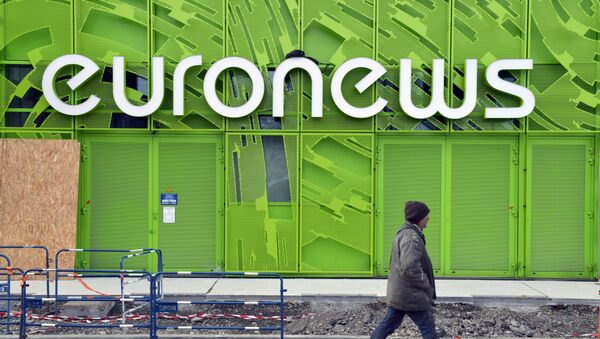 A photo taken on February 6, 2014 shows a man walking past the Euronews building in Lyon's new Confluence district. - Sputnik France