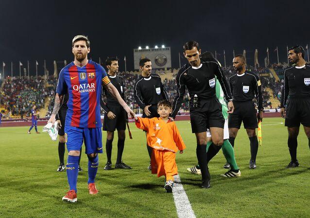 Lionel Messi et Murtaza Ahmadi