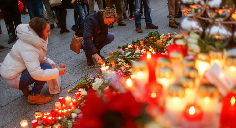 Mourners light candles at the Christmas market in Berlin, Germany, December 20, 2016