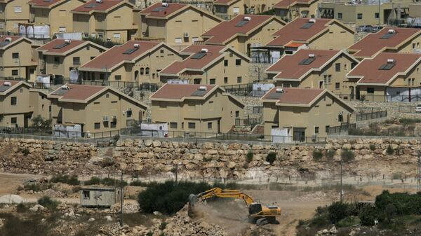 FILE - In this Monday, Sept. 27, 2010 file photo, Israeli earth-moving equipment works in the Jewish settlement of Kiryat Netafim, near the West Bank village of Salfit. - Sputnik France