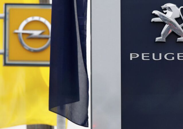 The logos of French car maker Peugeot and German car maker Opel are seen at a dealership in Villepinte, near Paris, France, February 20, 2017.