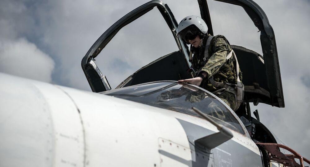 Pilote russe dans la base aérienne de Hmeimim en Syrie
