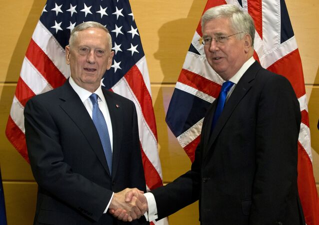 US Secretary of Defense Jim Mattis, left, shakes hands with British Secretary of State for Defense Michael Fallon