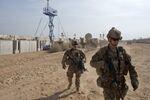 U.S. Army soldiers move through Qayara West Coalition base in Qayara, some 50 kilometers south of Mosul, Iraq, Wednesday, Nov. 9, 2016