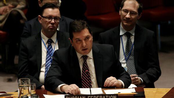 Le représentant permanent adjoint de la Russie à l'Onu, Vladimir Safronkov, lors du vote au Conseil de sécurité sur la résolution impliquant des sanctions contre la Syrie - Sputnik France