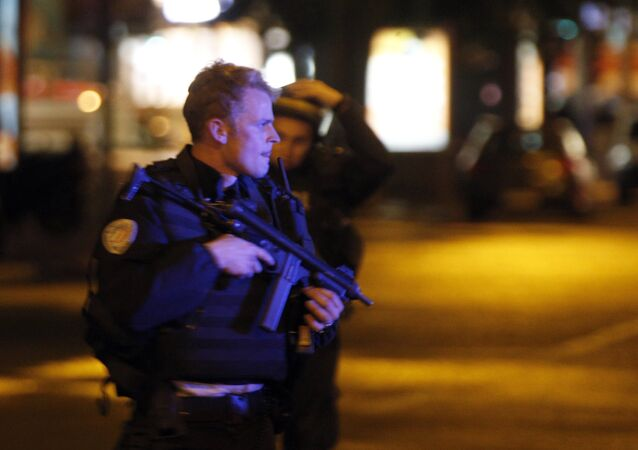 Police officers take positions on the Champs Elysees avenue in Paris, France, after a fatal shooting in which a police officer was killed along with an attacker, Thursday, April 20, 2017.