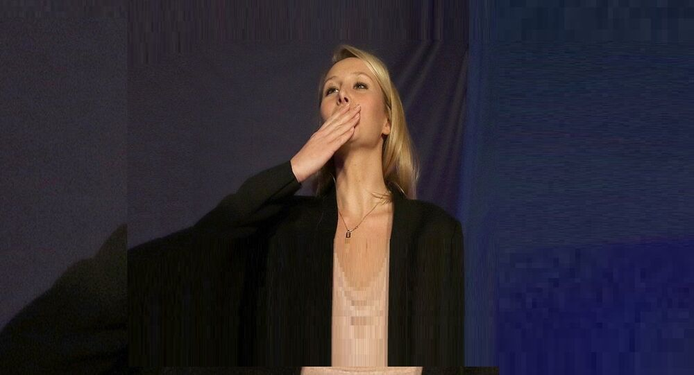Far right National Front party regional leader for southeastern France, Marion Marechal-Le Pen blows a kiss to supporters , at a meeting with supporters, after the first round of the regional elections, in Carpentras, southern France, Sunday, Dec. 6, 2015.