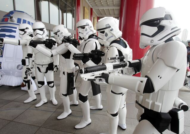 Fans dressed as movie Star Wars characters pose as they cerebrate the Star Wars Day in Taipei, Taiwan, Wednesday, May 4, 2016