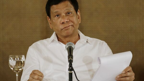 In this Monday, March 13, 2017 file photo, Philippine President Rodrigo Duterte reacts during a press conference at the Malacanang presidential palace in Manila, Philippines. - Sputnik France