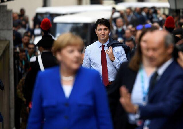 Quand Justin Trudeau impressionne Merkel avec ses chaussettes