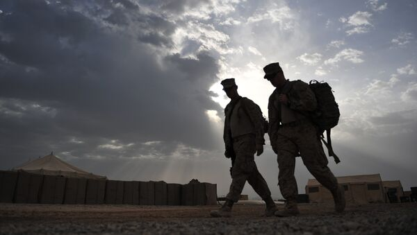 US Marines from 2nd Marine 8 Battalion (2/8) take an early morning walk at Camp Hansen, in Marjah, Helman Province, on May 4, 2011. - Sputnik France