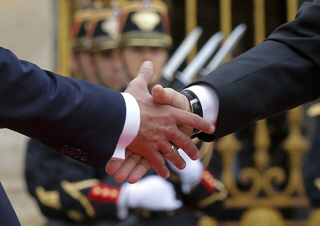 French President Emmanuel Macron (L) shakes hands with Russian President Vladimir Putin during a meeting at the Chateau de Versailles near Paris, France, May 29, 2017.