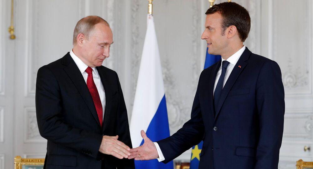 Vladimir Poutine et Emmanuel Macron à Versailles, image d'illustration