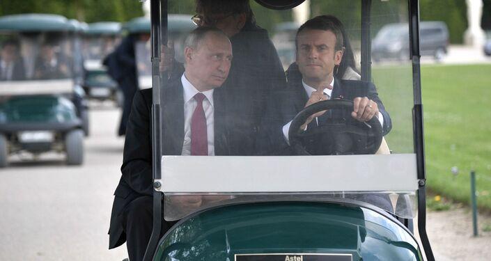 Vladimir Poutine et Emmanuel Macron au palais de Versailles