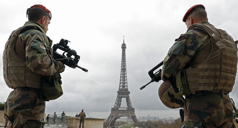 French army paratroopers patrol near the Eiffel tower in Paris.