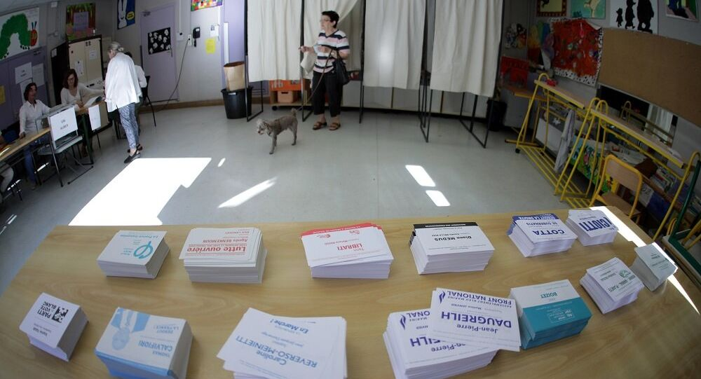 A person leaves a polling booth during the first round of French parliamentary election in Nice