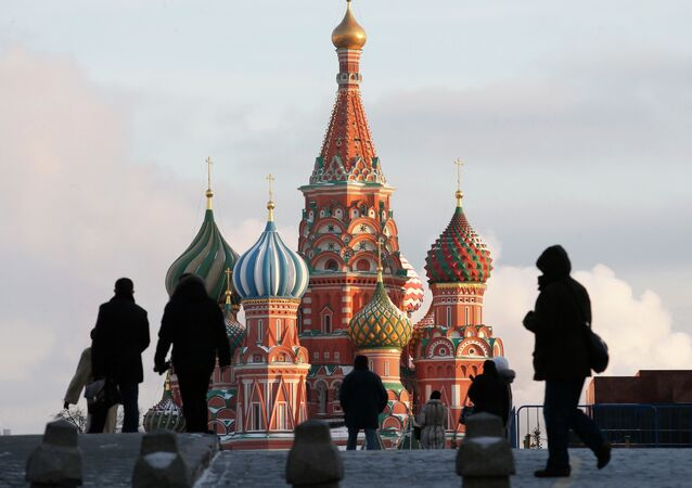 People walk in Red Square, with St. Basil's Cathedral seen in the background, in central Moscow February 6, 2015