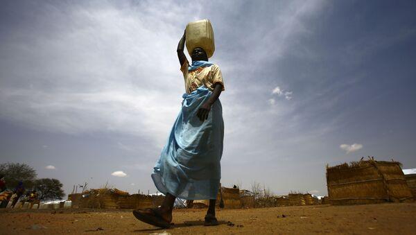 Беженка из Южного Судана в лагере для беженцев в Судане - Sputnik France