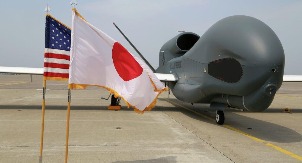 An advanced Global Hawk surveillance drone is displayed outside its hangar at Misawa Air Base in northern Japan Friday, May 30, 2014.