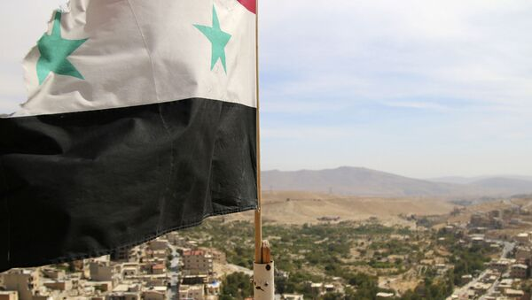 In this photo taken on Sunday, Oct. 18, 2015, a Syrian flag flies above the village of Maaloula, north of Damascus, Syria - Sputnik France