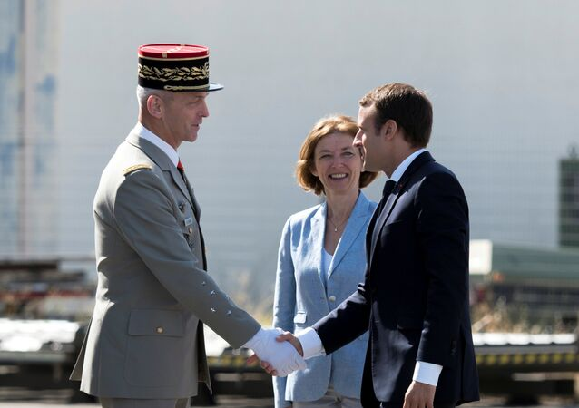 French President Emmanuel Macron greets newly-named Chief of the Defence Staff French Army General Francois Lecointre near French Defence Minister Florence Parly during a visit at the military base in Istres, southern France, July 20, 2017.