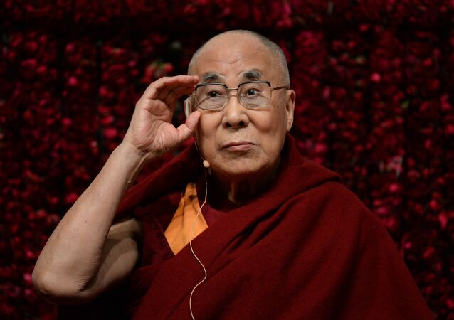 """Tibetan spiritual leader, the Dalai Lama, gestures before delivering a public lecture on """"Reviving Indian Wisdom in Contemporary India"""" at a function in New Delhi on February 5, 2017"""