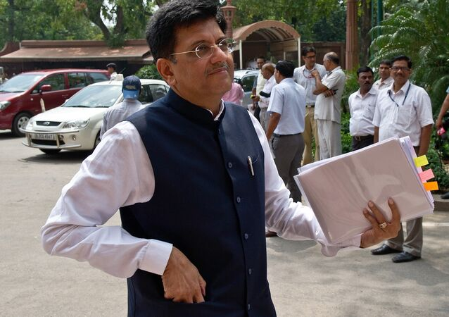 Indian Power and Coal Minister Piyush Goyal Indian Power and Coal Minister Piyush Goyal arrives in Parliament in New Delhi on July 21, 2014. The government said that ur*gent steps are being taken to address the 'crisis' faced by power plants because of shortage of coal and blamed the previous UPA government for the critical situation. AFP PHOTO/Prakash SINGH PRAKASH SINGH / AFP