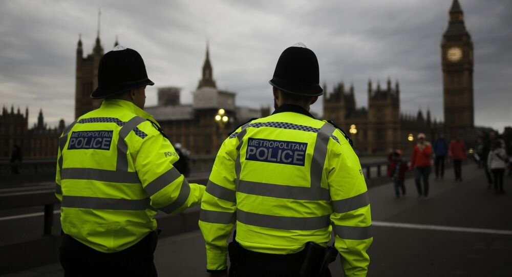 Police officers patrol Westminster Bridge with the Houses of Parliament in the background, on election day in London, Thursday, June 8, 2017.