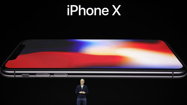 Apple CEO Tim Cook announces the new iPhone X at the Steve Jobs Theater on the new Apple campus, Tuesday, Sept. 12, 2017, in Cupertino, California. - Sputnik France
