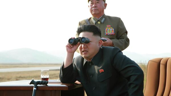 North Korean leader Kim Jong Un looks through a pair of binoculars as he guides a flight drill for the inspection of airmen of the Korean People's Army (KPA) - Sputnik France