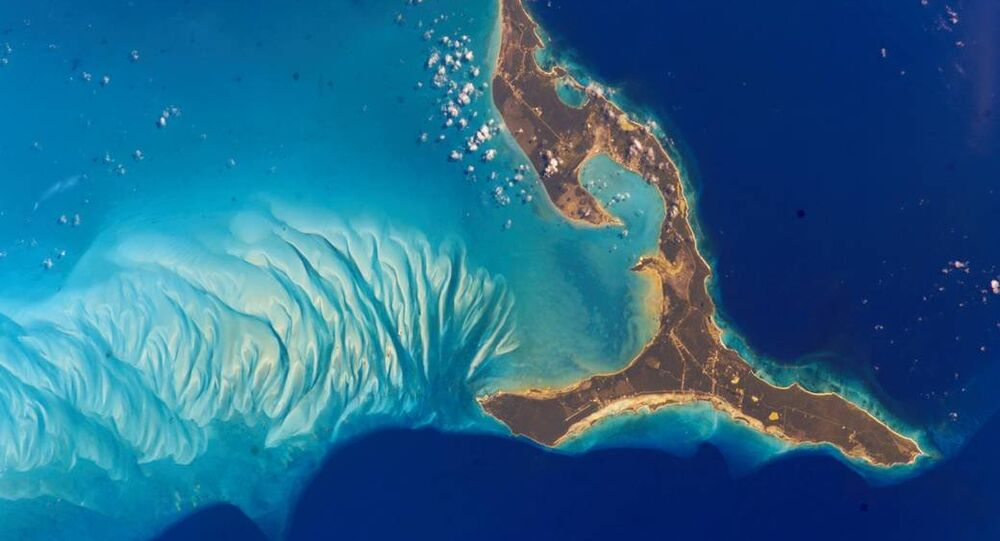 The south end of Eleuthera Island in the Bahamas shimmers in turquoise waters in this 2002 photo from the International Space Station.