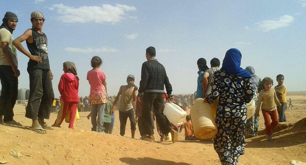 Des réfugiés syriens dans le camp d'Al-Rukban