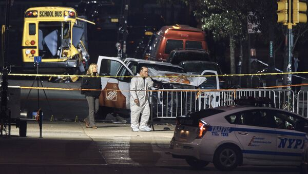 Police work near a damaged Home Depot truck after a motorist drove onto a bike path near the World Trade Center memorial, striking and killing several people, Wednesday, Nov. 1, 2017, in New York. - Sputnik France