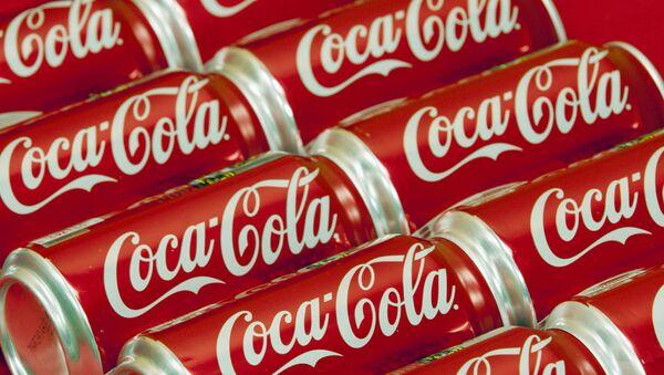 FILE - This July 15, 2013 file photo shows cans of Coca-Cola in Doral, Fla. - Sputnik France